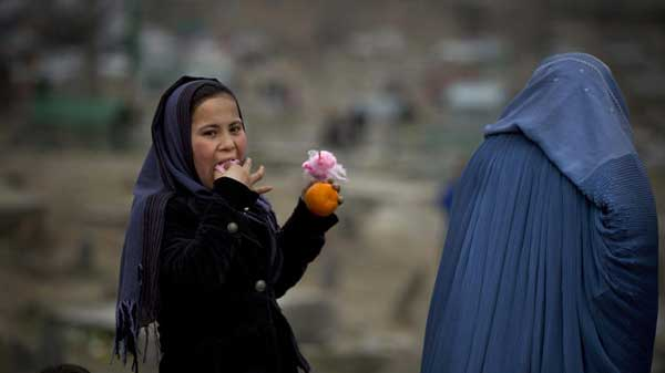 Afghan girl eats cotton candy